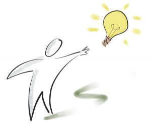 Figur zeigt auf Glühbirne